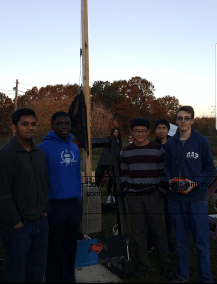 Our team of physics students with the completed trebuchet