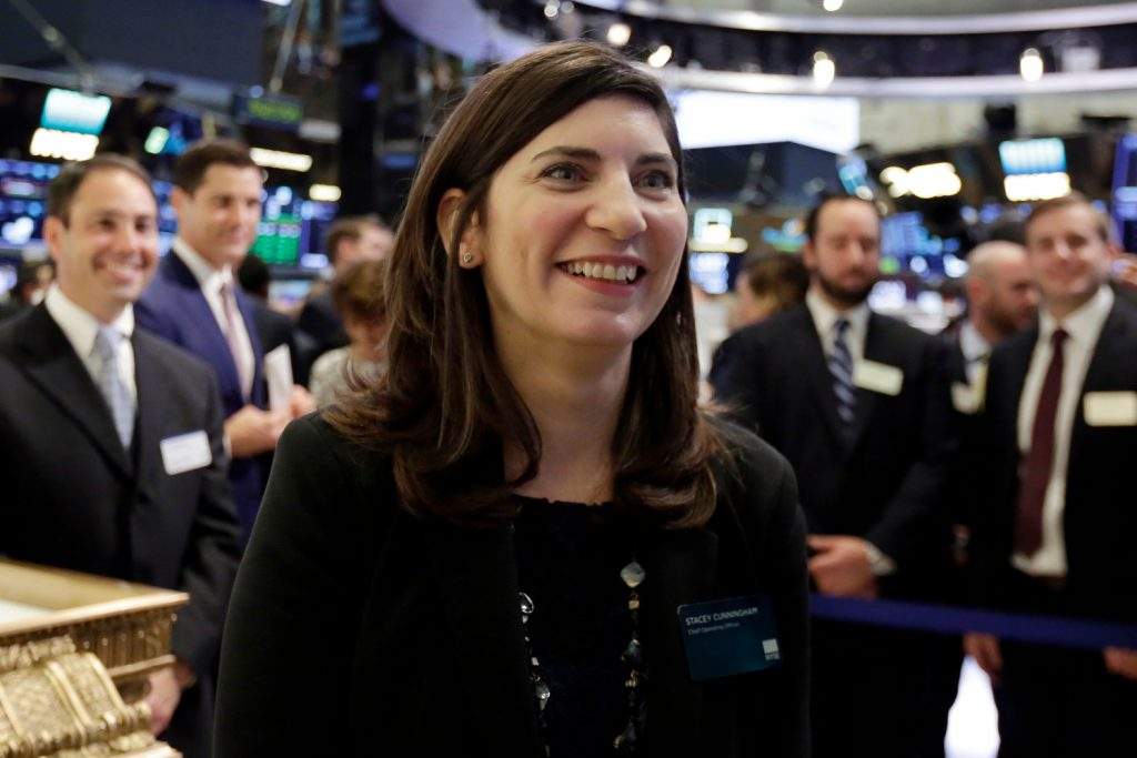 Photo by Richard Drew/AP/REX/Shutterstock (9689386b) Stacey Cunningham, the current New York Stock Exchange COO, who will become the exchange's 67th president, visits the floor of the NYSE, . Cunningham will become the first female leader in the history of the 226-year-old exchange NYSE First Female Leader, New York, USA - 22 May 2018